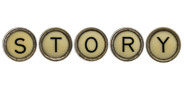 story word in old round typewriter keys isolated on white