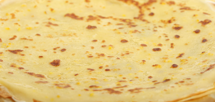 Crepe background. A detailed photo fried thin pancake.