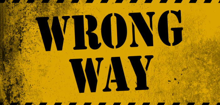 Wrong way sign yellow with stripes