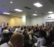 Delegates listening to conference speaker