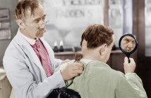 Barber shaving off too much hair from the back of a man's head
