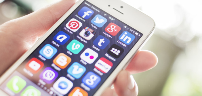 Mobile phone showing social media icons