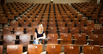 College student alone in large lecture hall