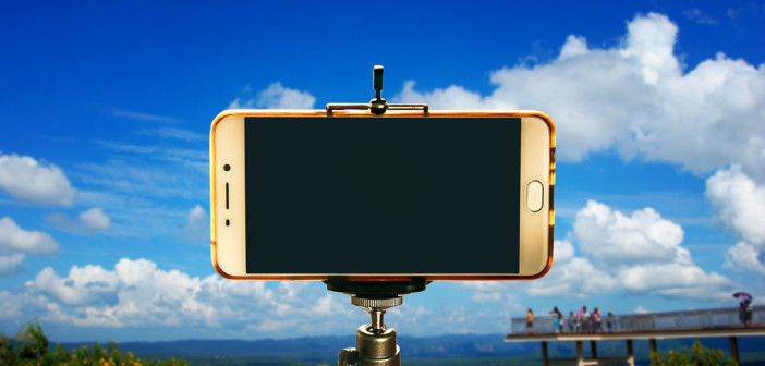 A smartphone on tripod ready to shoot a video or a photo