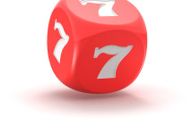 Red dice with lucky seven on the white background