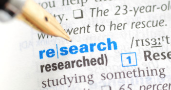 The word research highlighted in a dictionary
