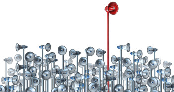 Communications leader concept with a red bullhorn or megaphone rising above the rest of the group of competitors as a business and financial symbol of seding a successful message through promotion and marketing.