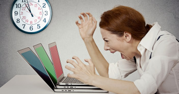 businesswoman screaming at computer