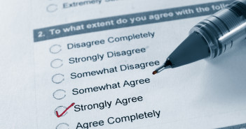 Survey answers being ticked by a pen