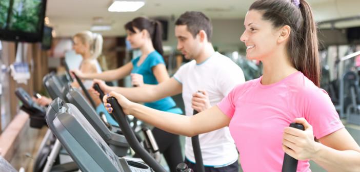 people training on simulators in gym