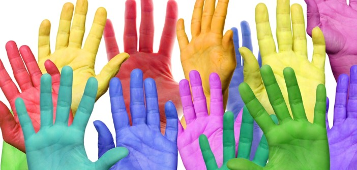 many colorful hands waving
