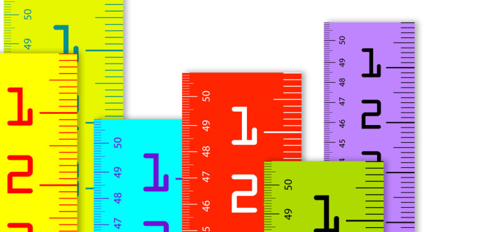colorful Millimeter and inch rulers isolated on a white background.