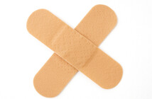 two sticking plasters in a cross shape