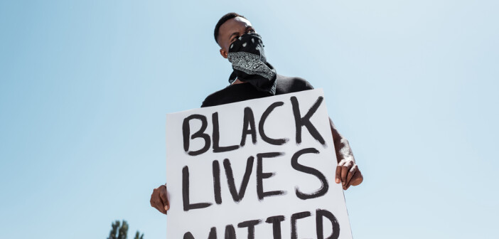 Man holding black lives matter sign