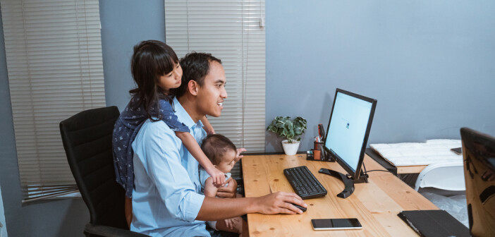 businessman working from home while babysitting. parent with child working at home
