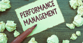 The words performance management written on a note
