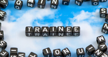 The word trainee on the sky background